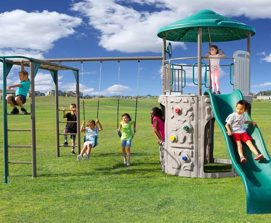 Adventure Tower Swing Set with monkey bars, swing, lookout tower with slide and climbing wall - An outdoor playset that provides hours of fun for kids and is low maintenance for parents